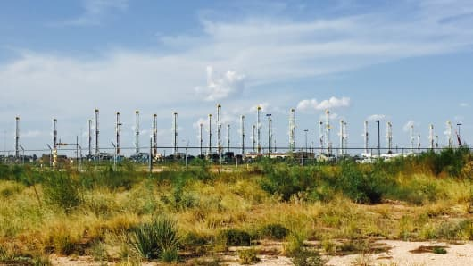 Nearly 40 inactive rigs are stored in a business park in Midland, Texas.